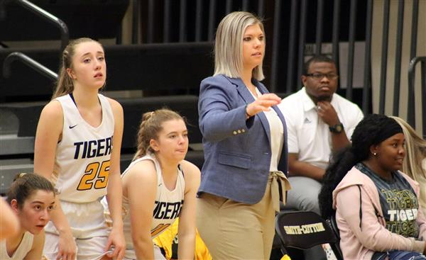 S-C Girls Basketball Head Coach Jessie Arnold and the bench