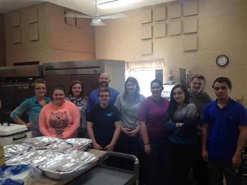 Service Learning and Foods Class cooking dinner for Tambo Apartments